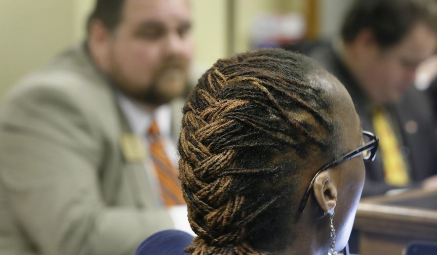 Hir braider Nivea Earl Thornton, right, testifies before a meeting of the House Committee on Public Health at the Arkansas state Capitol in Little Rock, Ark., Thursday, Feb. 12, 2015, as Rep. Bob Ballinger, R-Hindsville, left, listens. The committee endorsed a bill by Ballinger where African-style hair braiders would be exempt from state cosmetology laws. (AP Photo/Danny Johnston)