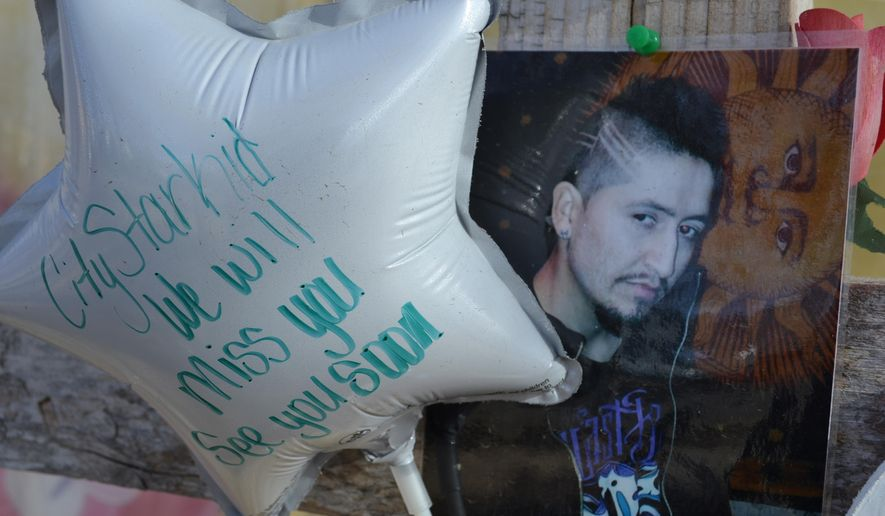 In this photograph taken on Thursday, Feb. 5, 2015, in Rocky Ford, Colo., a balloon in the shape of a star carries a written message as it sits next to a photograph of Jack Jacquez in a memorial to the 27-year-old man who was shot and killed in the home that he shared with his mother by a Rocky Ford, Colo., Police Department officer on Oct. 12, 2014. Former Rocky Ford policeman James Ashby has been charged with second-degree murder in the case, the first Colorado lawman in more than two decades to face murder charges for an on-duty shooting. (AP Photo/P. Solomon Banda)
