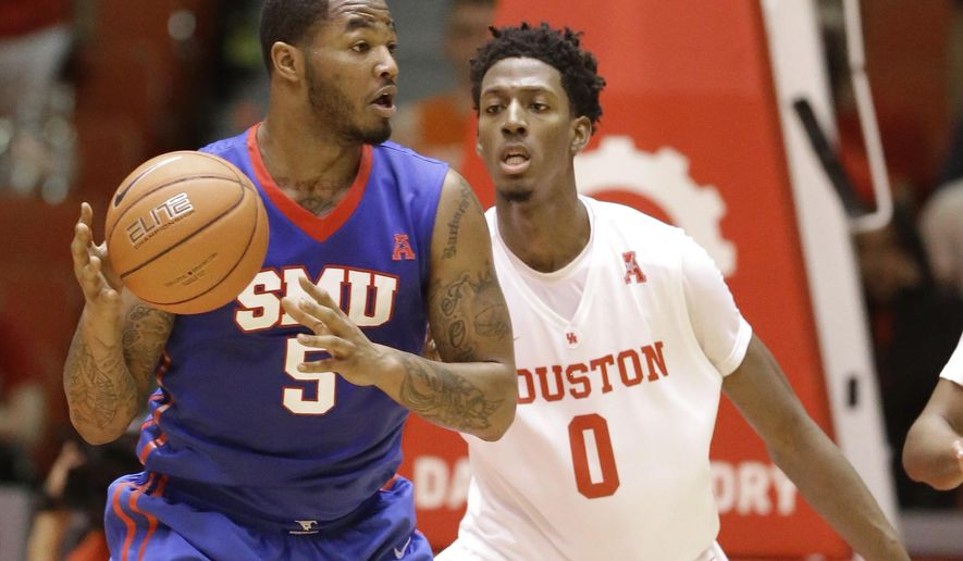 SMU's Markus Kennedy (5) looks to pass in front of Houston's Danrad Knowles (0) in the second half of an NCAA college basketball game, Thursday, Feb. 12, 2015, in Houston. (AP Photo/Pat Sullivan)