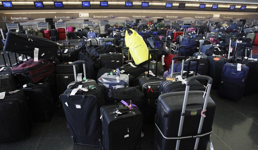 Luggage sits inside Terminal 8 at JFK International Airport in New York, Wednesday, July 30, 2008.  A computer software glitch crippled the baggage handling system at an American Airlines terminal at Kennedy Airport on Wednesday, delaying some flights and causing a luggage pileup at the ticket counters. (AP Photo/Rick Maiman)