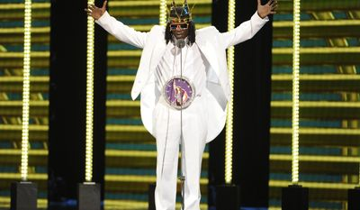 Flavor Flav speaks on stage during the 2014 Soul Train Awards at Orleans Arena on Friday, Nov. 7, 2014, in Las Vegas. (Photo by Chris Pizzello/Invision/AP)