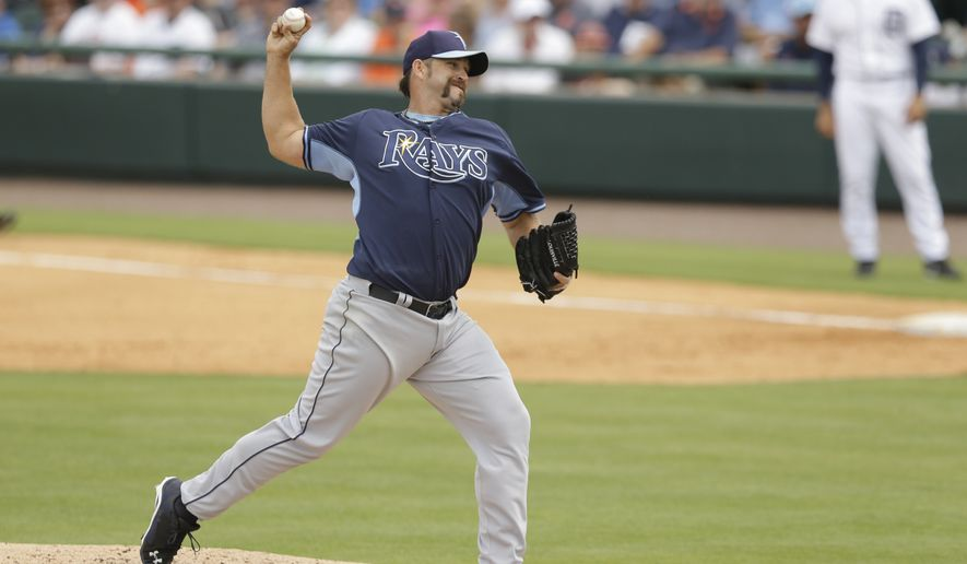 Tampa Bay Rays relief pitcher Heath Bell throws during the fifth inning of a spring exhibition baseball game against the Detroit Tigers in Lakeland, Fla., Friday, March 28, 2014. (AP Photo/Carlos Osorio)