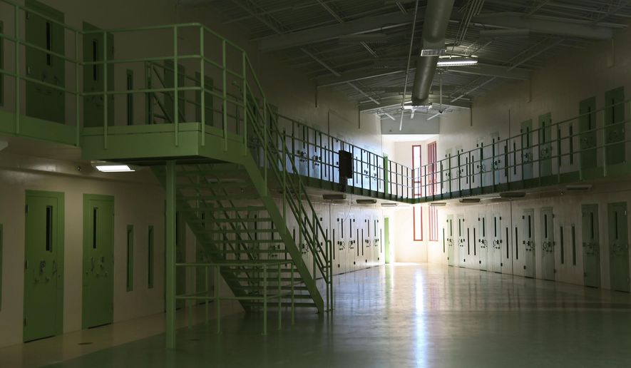 FILE - In this Jan, 19, 2012  file photo is a  view of a cell pod at the new Iowa State Penitentiary in Fort Madison, Iowa. Corrections officials say they weren't trying to mislead the public when they refused to acknowledge for months that the price tag for the state's faulty new prison had risen to $166 million. The department confirmed Wednesday, Feb. 12, 2015 that an often-cited $132 million cost for the empty Iowa State Penitentiary is inaccurate.  (AP Photo/The Des Moines Register, Mary Willie, File) MAGS OUT, TV OUT, NO SALES, MANDATORY CREDIT