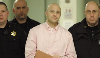 Hugo Selenski, center, is led from the Luzerne County Courthouse in Wilkes-Barre, Pa., Wednesday, Feb. 11, 2015, after being convicted of first degree murder and other charges in the deaths of Michael Kerkowski and Tammy Fassett. (AP Photo/The Citizens' Voice, Mark Moran)