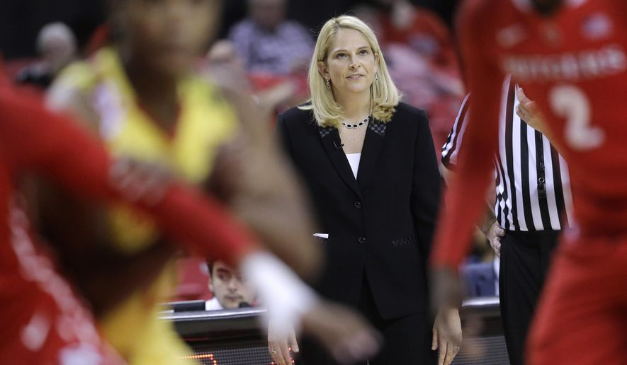 Maryland coach Brenda Frese watches a free throw attempt in the second half of her team's NCAA college basketball game against Rutgers, Tuesday, Feb. 10, 2015, in College Park, Md. Maryland won 80-69. (AP Photo/Patrick Semansky)