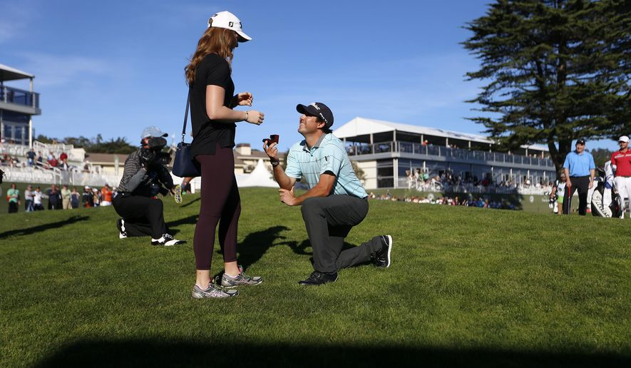 Mark Hubbard proposes to his girlfriend, Meaghan McCurley, on the 18th hole at Pebble Beach following his first round of the Pebble Beach National Pro-Am golf tournament in Pebble Beach, Calif., on Thursday, Feb. 12, 2015. McCurley said yes. (AP Photo/San Jose Mercury News, Nhat V. Meyer)