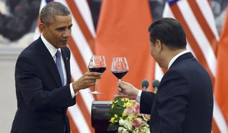 President Barack Obama, left, toasts with Chinese President Xi Jinping on Nov. 12 at a lunch banquet in the Great Hall of the People in Beijing. China has become one of the world's largest two economies, and is wealthy enough to buy up at least $1.3 trillion of the U.S. debt. But that hasn't stopped Uncle Sam from continuing to send foreign aid to Beijing. (Associated Press)