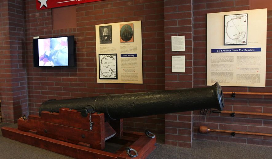 ADVANCE FOR USE MONDAY, FEB. 16 - In this photo taken Feb. 2, 2015, a cannon from the Brutus, one of the first four ships of the Texas Navy, is on display at the Texas Seaport Museum's new Texas Navy exhibit in Galveston, Texas. The cannon has a storied history, from sinking aboard the Brutus in an 1837 hurricane, to being discovered during an 1884 dredging project. It was late buried after the 1900 storm, and then found again in Galveston in the 1970s in a construction project. (AP Photo/The Galveston County Daily News, Jennifer Reynolds) MANDATORY CREDIT, MAGS OUT, TV OUT