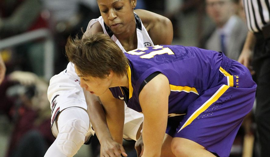 LSU guard Rina Hill (13) tries to keep the ball away from South Carolina guard Tiffany Mitchell in the first half of an NCAA college basketball game in Columbia, S.C., Thursday, Feb. 12, 2015. (AP Photo/Travis Bell)