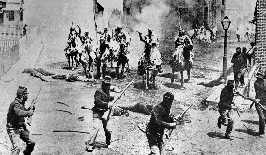 """FILE - This 1914 file photo shows a scene from D.W. Griffith's """"Birth of a Nation"""" movie depicting Ku Klux Klan members riding horses against soldiers, filmed in the Hollywood section of Los Angeles. Based on Thomas Dixon's novel, """"The Clansman,"""" it was set in the American Civil War. Earlier films often lasted less than an hour and were completed within days. """"Birth of a Nation"""" took six months to produce, had a running time of 195 minutes and employed hundreds of actors. In 1992, the Library of Congress added Griffith's work to the National Film Registry, calling it a """"controversial, explicitly racist, but landmark American film masterpiece."""" (AP Photo)"""