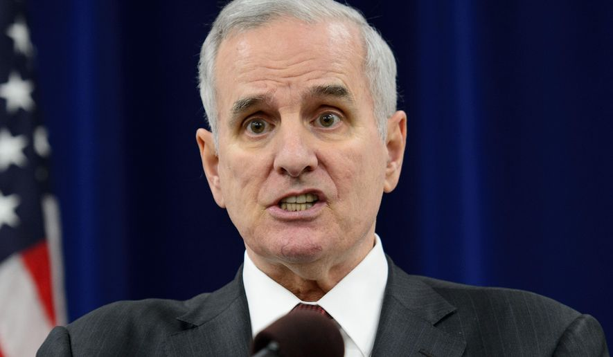 """Gov. Mark Dayton talks to the media during a news conference in St. Paul, Minn., Thursday, Feb. 12, 2015. Minnesota Senate vote to roll back pay raises for state commissioners exposed a deep rift Thursday between Dayton and Senate Majority Leader Tom Bakk, a fellow Democrat the governor says """"connives behind my back."""" (AP Photo/Star Tribune, Glen Stubbe)"""
