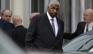Sports commentator and former Georgetown University basketball coach John Thompson leaves following a private church service for former North Carolina basketball coach Dean Smith in Chapel Hill, N.C., Thursday, Feb. 12, 2015. Smith died Saturday, Feb. 7, 2015. (AP Photo/Gerry Broome)