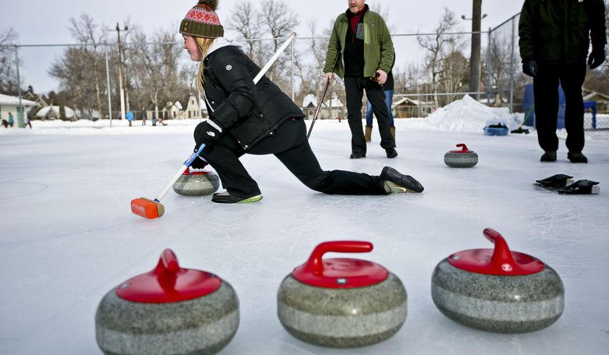 ADVANCE FOR USE MONDAY, FEB. 16 - In this photo taken Jan. 17, 2015, curling enthusiasts participate in a curling clinic hosted by the Bozeman Parks and Recreation Department at Southside Park in Bozeman, Mont.. Participants learn the basics of the game and help raise interest in the sport. (AP Photo/Bozeman Daily Chronicle, Adrian Sanchez-Gonzalez)