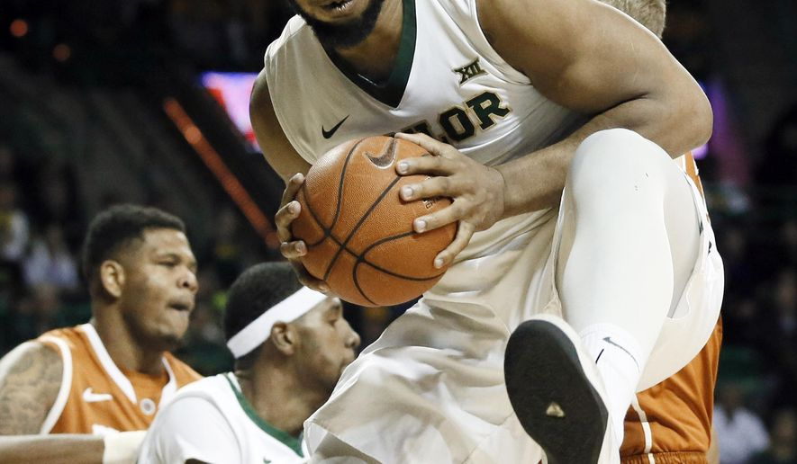 "FILE - In this jan. 31, 2015, file photo Baylor forward Rico Gathers (2) comes down with one of his 11 first-half rebounds in an NCAA college basketball game against Texas in Waco, Texas. Off the court, Rico Gathers Sr. is a family man with a wife and young son. During games with No. 16 Baylor, the imposing 6-foot-8 post admittedly becomes ""real disrespectful'' going every possible rebound. (AP Photo/Tony Gutierrez, File)"