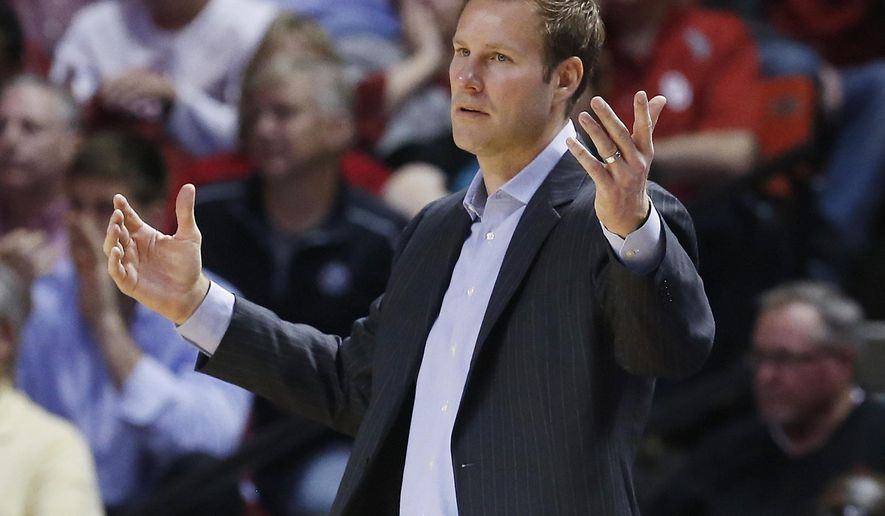Iowa State head coach Fred Hoiberg gestures in the second half of an NCAA college basketball game against Oklahoma in Norman, Okla., Monday, Feb. 9, 2015. Oklahoma won 94-83. (AP Photo/Sue Ogrocki)