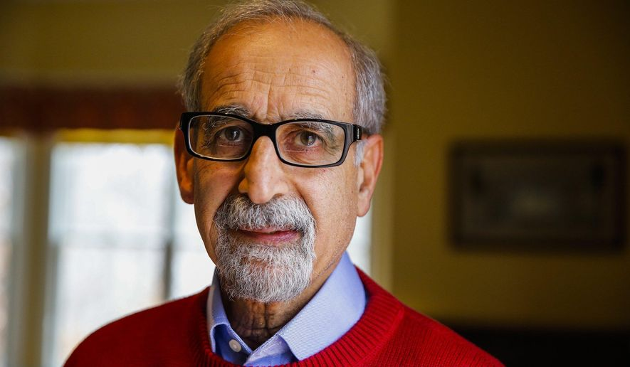 Dr. Raj Haddawi  in his home Feb. 4, 2015 in Bloomington, Ind. Haddawi led a drive to create Volunteers in Medicine of Monroe County after he retired eight years ago. The clinic provides health care to uninsured residents of Monroe and Owen counties. Most years since its inception, the clinic has seen tens of thousands of patient visits. (AP Photo/Bloomington Herald-Times, Jeremy Hogan)
