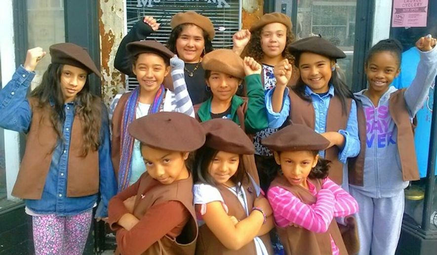 "Young members of a new girls troop in Oakland called the ""Radical Brownies"" don brown berets and participate in ""Black Lives Matter"" protests in order to help spread a message of racial justice. (Facebook/Radical Brownies)"