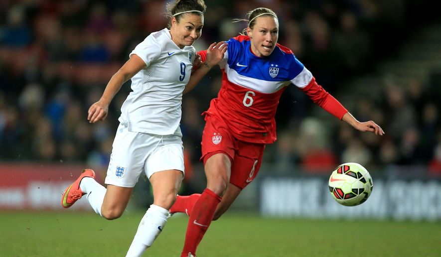 England's Jodie Taylor , left,  battles for the ball with Whitney Engen of the US, during the international friendly match between England and the US,  at the Stadium:mk, in Milton Keynes, England, Friday Feb. 13, 2015. (AP Photo/PA, Nick Potts) UNITED KINGDOM OUT