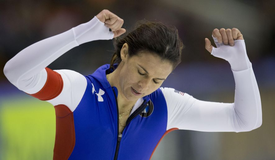 Brittany Bowe of the U.S. celebrates winning the women's 1000 meter race of the speedskating single distance world championships at Thialf ice rink in Heerenveen, Netherlands, Friday, Feb. 13, 2015. (AP Photo/Peter Dejong)