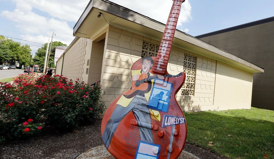 FILE - In this Aug. 8, 2014, file photo, a guitar painted with the likeness of Elvis Presley stands outside RCA Studio B in Nashville, Tenn., where Presley recorded during his career. Nashville planning officials on Thursday, Feb. 12, 2015, placed a moratorium on new developments on Nashville's famous Music Row while seeking to come up with a plan to balance growth with the neighborhood's history and culture. (AP Photo/Mark Humphrey, File)