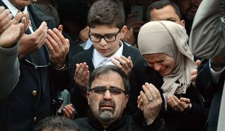 Namee Barakat, center, watches during funeral services for his son, Deah Shaddy Barakat, Thursday, Feb. 12, 2015, in Wendell, N.C.  Barakat, 23, his wife, Yusor Mohammad Abu-Salha, 21, and her sister Razan Mohammad Abu-Salha, 19, were found dead Tuesday at their home near the University of North Carolina-Chapel Hill campus. Charged with three counts of first-degree murder is Craig Stephen Hicks. (AP Photo/The News & Observer, Chuck Liddy)