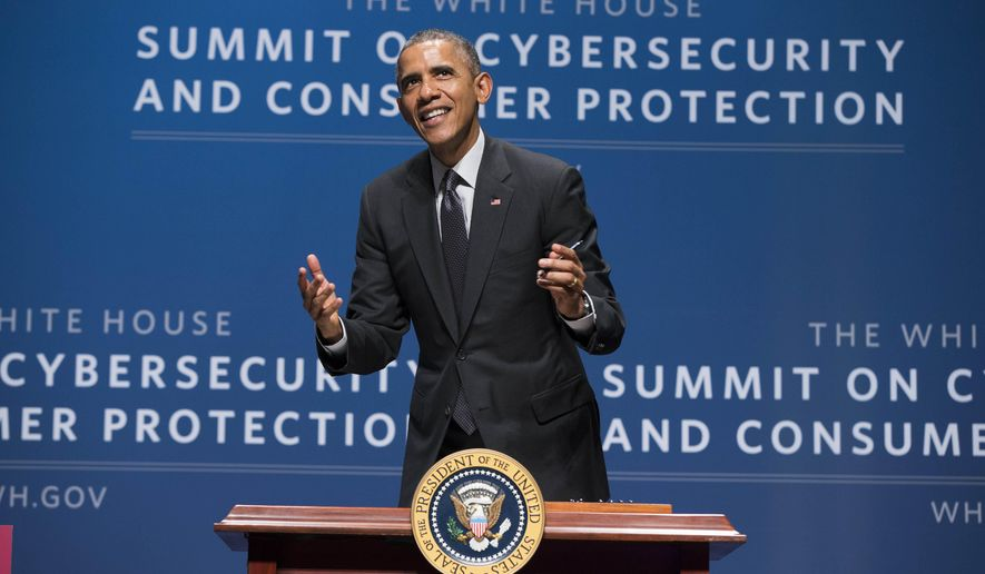 President Barack Obama smiles as he signs an executive order promoting private sector cybersecurity information sharing during a summit on cybersecurity and consumer protection, Friday, Feb. 13, 2015, at Stanford University in Palo Alto, Calif. (AP Photo/Evan Vucci)