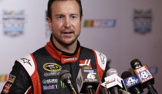 Kurt Busch answers questions during NASCAR media day at Daytona International Speedway, Thursday, Feb. 12, 2015, in Daytona Beach, Fla. (AP Photo/John Raoux)