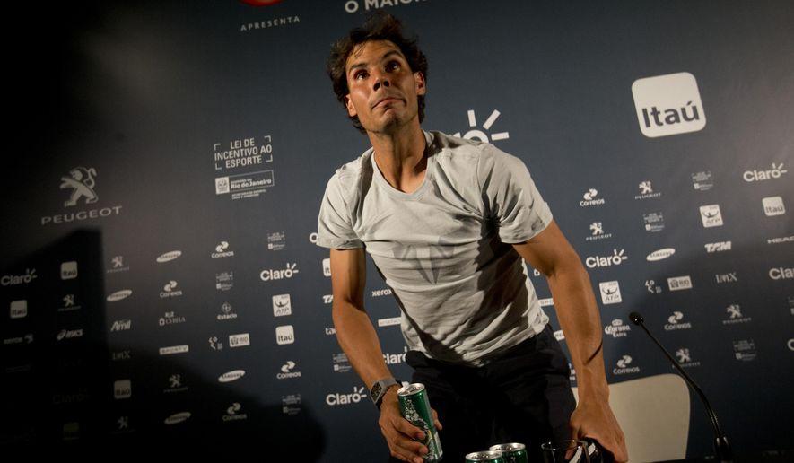 Rafael Nadal, of Spain, leaves after a press conference ahead of the Rio Open in Rio de Janeiro, Brazil, Friday, Feb. 13, 2015. The Rio Open tennis tournament starts Monday Feb. 16. (AP Photo/Silvia Izquierdo)