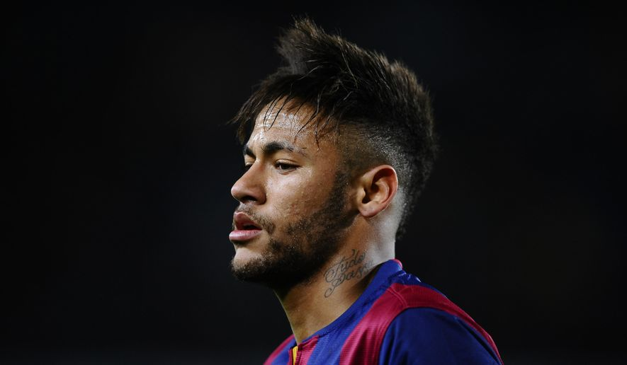 FC Barcelona's Neymar, from Brazil, looks on during a semifinal, first leg, Copa del Rey soccer match between FC Barcelona and Villarreal at the Camp Nou stadium in Barcelona, Spain, Wednesday, Feb. 11, 2015. (AP Photo/Manu Fernandez)