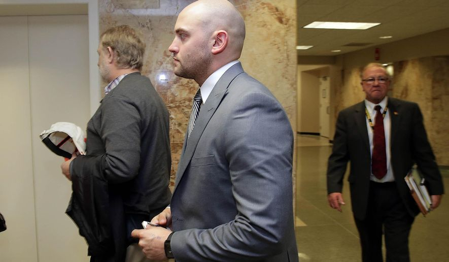 Former Tulsa Co. deputy Gerald Nuckolls leaves the courtroom after a hearing on his sexual battery charges at the Tulsa County Courthouse in Tulsa, Okla., Friday, Feb. 13, 2015.  Nuckolls, 26, who has pleaded not guilty, was ordered to trial on two counts of sexual battery and two counts of indecent exposure following a preliminary hearing in Tulsa County District Court.  (AP Photo/Tulsa World,  Michael Wyke)  ONLINE OUT; KOTV OUT; KJRH OUT; KTUL OUT; KOKI OUT; KQCW OUT; KDOR OUT; TULSA OUT; TULSA ONLINE OUT