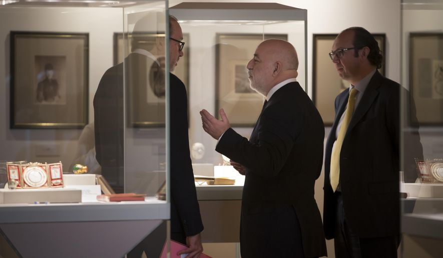 Russian businessman Viktor Vekselberg, the founder of the Faberge Museum, centre, speaks prior to a ceremony held to mark the donation of unique items from the personal archive of the Yusupovs, one of the richest and most powerful Russian noble families, after they were returned to Russia and donated to the State Archive of the Russian Federation in St. Petersburg, Russia, Friday, Feb. 13, 2015. (AP Photo/Dmitry Lovetsky)