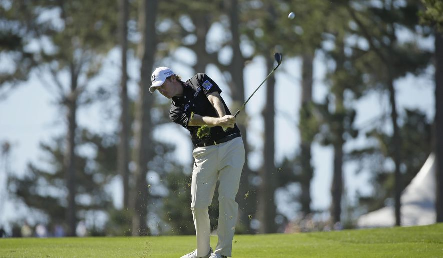 Brandt Snedeker hits from the fairway down to the 10th green of the Spyglass Hill Golf Course during the second round of the AT&T Pebble Beach National Pro-Am golf tournament Friday, Feb. 13, 2015, in Pebble Beach, Calif. (AP Photo/Eric Risberg)