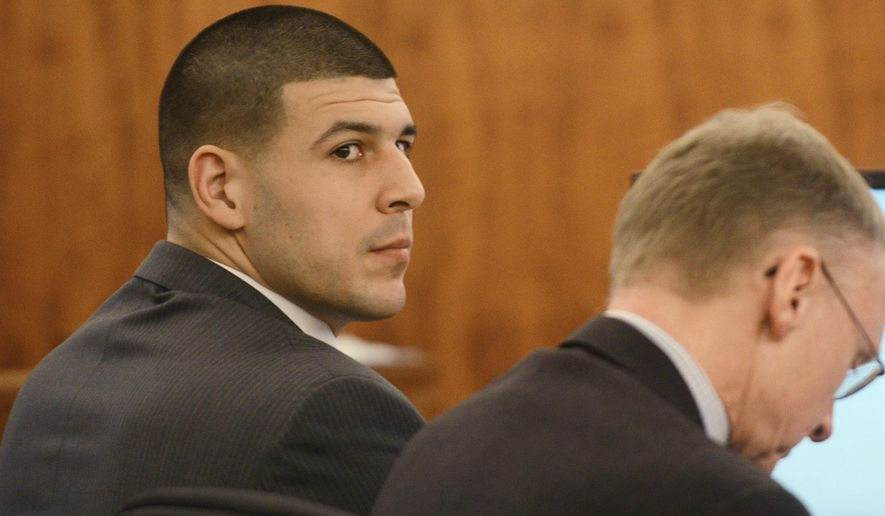 Aaron Hernandez, left, sits with his attorney Charles Rankin during his trial  at Bristol Superior Court on Wednesday, Feb. 11, 2015 in Fall River, Mass. Hernandez is charged with killing semiprofessional football player Odin Lloyd, 27, in June 2013. (AP Photo/The Boston Herald, Ted Fitzgerald, Pool)