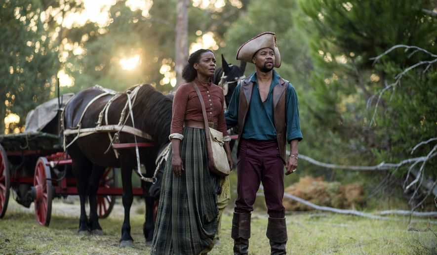 "This image released by Entertainment One/BET shows Aunjanue Ellis, left, and Cuba Gooding Jr. in a scene from ""The Book of Negros,"" a six-part miniseries starting Monday Feb. 16, at 8PM ET/PT. (AP Photo/Entertainment One/BET, Joe Alblas)"