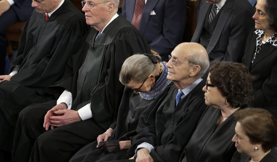 """In this photo taken Jan. 20, 2015 members of the Supreme Court, including Justice Ruth Bader Ginsburg, center, rests during President Barack Obama's State of the Union address on Capitol Hill in Washington. Ginsburg has a confession: She """"wasn't 100 percent sober"""" when she fell asleep at the president's State of the Union address last month. Ginsburg told an audience Thursday that she drank some wine at dinner before attending the speech, where cameras repeatedly caught her nodding off. The 81-year-old justice says she had dined with Justice Anthony Kennedy and couldn't resist the California wine he brought.  (AP Photo/Pablo Martinez Monsivais)"""