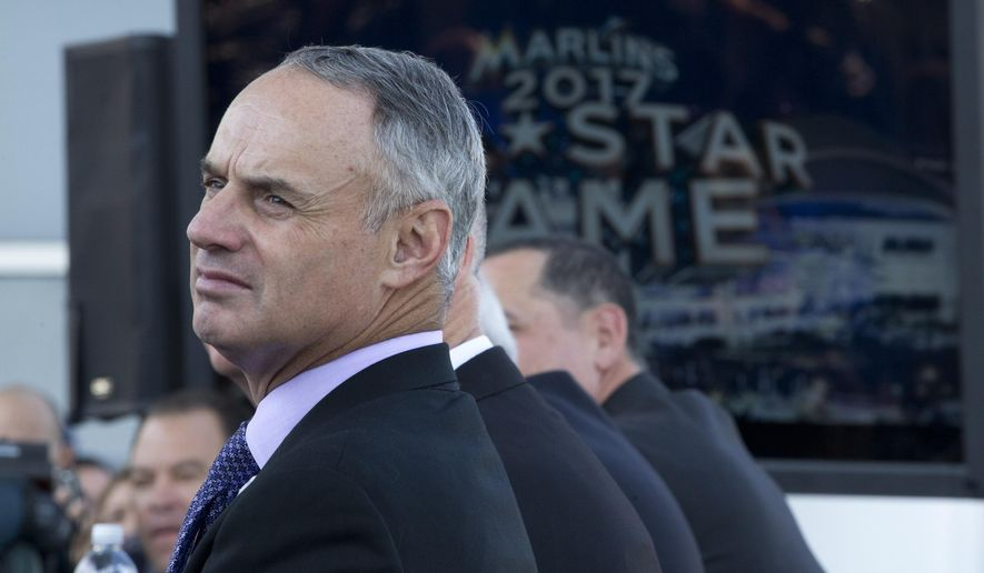Baseball commissioner Robert Manfred Jr. waits to announce the 2017 All-Star Game will be in Miami, during a news conference, Friday, Feb. 13, 2015  at the Miami Marlins ball park in Miami.(AP Photo/J Pat Carter)