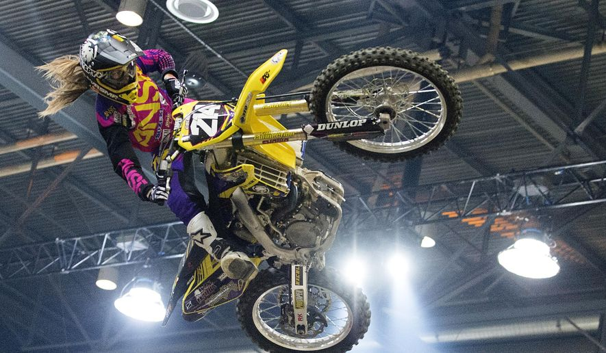 In this Dec. 5, 2014, file photo Vicki Golden competes at the Geneva International Supercross competition in Geneva, Switzerland. Golden nearly gave up motocross racing when she was unable to land a sponsor. Less than two years later, she's on the verge of history as she tries to become the first woman to qualify for a Supercross event. (AP Photo/Keystone, Anthony Anex, File)