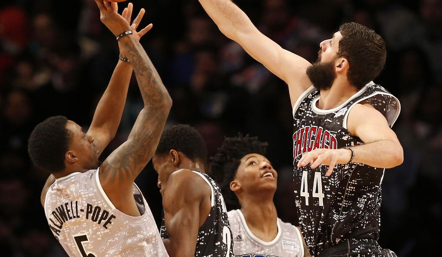 World Team's Nikola Mirotic, right, of the Chicago Bulls, blocks a shot by U.S. Team's Kentavious Caldwell-Pope, of the Detroit Pistons, during the second half of NBA basketball's Rising Stars Challenge, Friday, Feb. 13, 2015, in New York. (AP Photo/Julio Cortez)