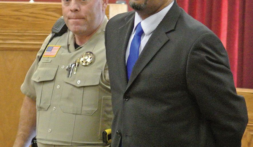 Yavapai County Sheriff's Office Detention Officer Shane Chaves escorts Marzet Farris III out of a courtroom in handcuffs after being found guilty for first degree murder and three other counts Thursday, Feb.  12, 2015 at the Yavapai County Courthouse in downtown Prescott, Ariz.  Sentencing for Farris will be on March 16.  (AP Photo/Matt Hinshw, The Daily Courier)