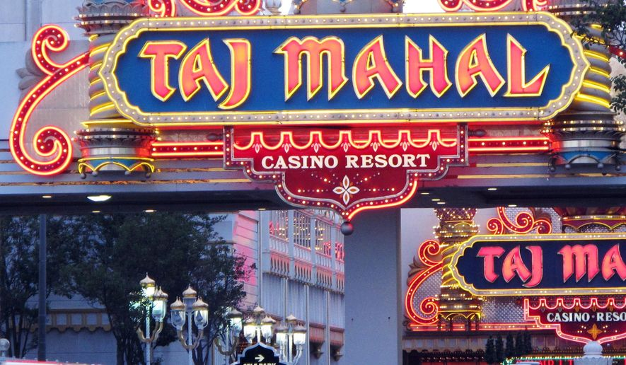 In this photo taken, Oct. 24, 2014 vehicles arrive at the Trump Taj Mahal Casino Resort in Atlantic City N.J. The casino's CEO said on Friday, Feb. 13, 2015 that it will close its money-losing poker room this weekend to begin renovations and re-open it by July 4th. (AP Photo/Wayne Parry)
