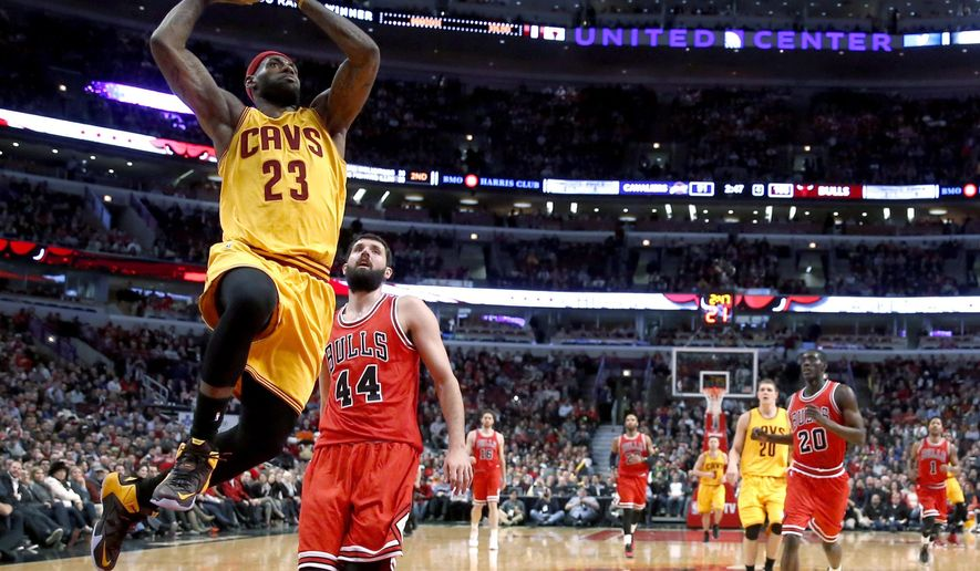Cleveland Cavaliers forward LeBron James (23) goes up for a dunk past Chicago Bulls forward Nikola Mirotic (44) during the second half of an NBA basketball game Thursday, Feb. 12, 2015, in Chicago. The Bulls won 113-98. (AP Photo/Charles Rex Arbogast)