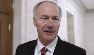 Arkansas Gov. Asa Hutchinson is interviewed in a hallway at the Arkansas state Capitol in Little Rock, Ark., Friday, Feb. 13, 2015. (AP Photo/Danny Johnston) ** FILE **