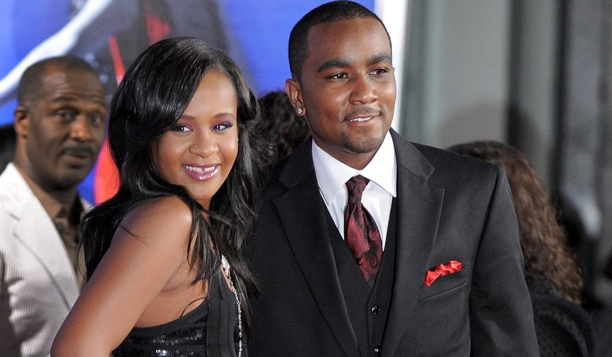 """FILE - In this Aug. 16, 2012, file photo, Bobbi Kristina Brown, left, and Nick Gordon attend the Los Angeles premiere of """"Sparkle"""" at Grauman's Chinese Theatre in Los Angeles. Bobbi Kristina was living with Gordon at the townhome where she was found in a bathtub.  (Photo by Jordan Strauss/Invision/AP, File)"""