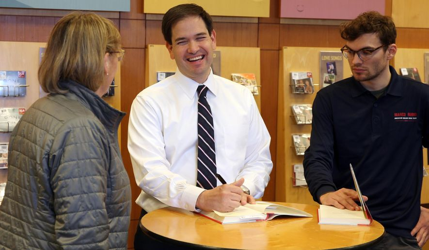 U.S. Sen. Marco Rubio (R-Fla.) meets with a supporter at a book signing event at the Barnes and Noble bookstore in West Des Moines, Iowa, on Friday, Feb. 13, 2015.   (AP Photo/The Des Moines Register, Bryon Houlgrave)  MAGS OUT, TV OUT, NO SALES, MANDATORY CREDIT