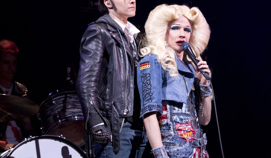 """In this image released by Boneau/Bryan-Brown, Lena Hall, left, and John Cameron Mitchell perform in """"Hedwig and The Angry Inch,"""" in New York. John Cameron Mitchell had stepped into the Tony Award-winning show he originated in 1998 when he injured his knee during the Feb. 7 show. He called it a """"accidental vacation"""" and will return to the show Tuesday. (AP Photo/Boneau/Bryan-Brown, Joan Marcus)"""