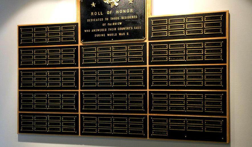 This photo taken on Feb. 6, 2015, shows the World War II plaque, that a group of Feyen Zylstra employees restored ver the course of three months in Grand Rapids, Mich. The nearly 5-foot-by-3-foot plaque is now on display in Feyen Zylstra's main hallway on the building's east side. (AP Photo/The Grand Rapids Press, Kyle Moroney) ALL LOCAL TELEVISION OUT; LOCAL TELEVISION INTERNET OUT