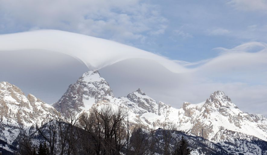 This photo taken Thursday, Feb. 12, 2015, and provided by the Grand Teton National Park, shows an unusual cloud formation across the summit of the Grand Teton in this view from the park's headquarters campus at Moose, Wyo. (AP Photo/Grand Teton National Park, Jackie Skaggs) ** FILE **