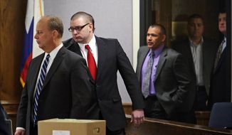 Former Marine Cpl. Eddie Ray Routh, second from left, enters the courtroom after a short mid-morning break for jurors during his capital murder trial at the Erath County, Donald R. Jones Justice Center in Stephenville, Texas, Friday, Feb. 13, 2015. Routh, 27, of Lancaster, is charged with the 2013 deaths of former Navy SEAL Chris Kyle and his friend Chad Littlefield at a shooting range near Glen Rose, Texas.  (AP Photo/The Fort Worth Star-Telegram, Paul Moseley, Pool)