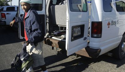 Under a newly reported Scouting policy, effective Sept. 1, 2105, big vans used to transport Scouts must be no older than a 2005 model and meet other safety requirements. (AP Photo/Danny Johnston)