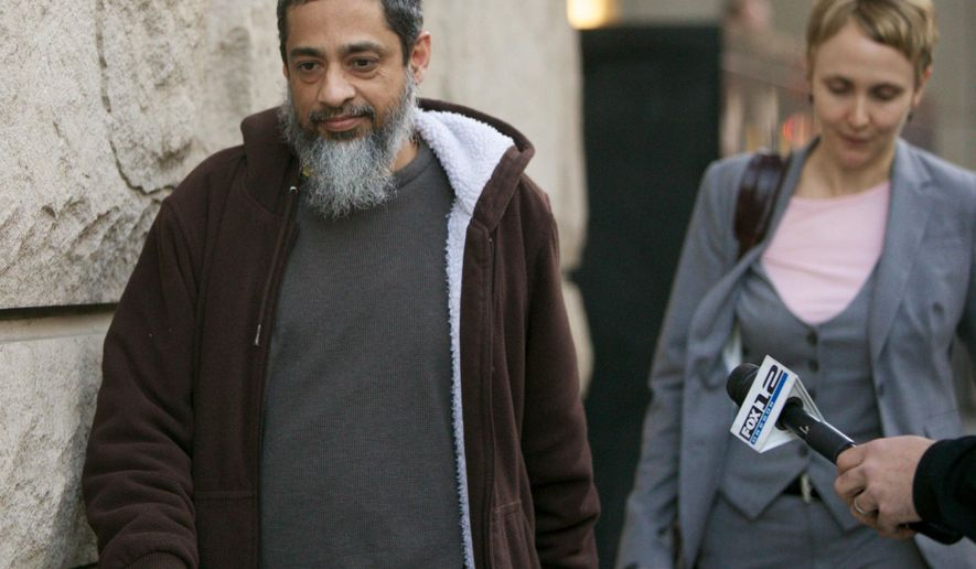 In this March 7, 2013 file photo, Reaz Khan leaves the the U.S. Federal Court building in Portland, Ore., after being released from custody  pending the a trial.  Khan, 51, admitted before U.S. District Court Judge Michael Mosman on Friday, Feb. 13, 2015 that he arranged for Ali Jaleel to receive $2,450 before Jaleel participated in the May 2009 attack. He also admitted providing financial help and advice to Jaleel's wives after the bombing, with the knowledge it would help them avoid capture.  (AP Photo/The Oregonian, Randy L. Rasmussen)